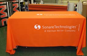 Oragne Six Foot Tablecloth With White Logo