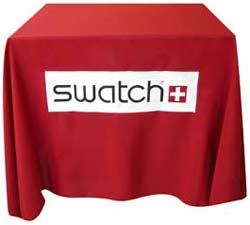 Red, four foot Custom Tablecloth with black, white and red logo.